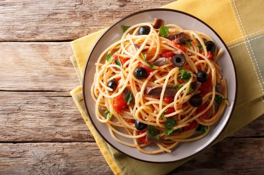 This delicious and scrumptious dish is made with tomatoes, anchovies, capers, garlic and few other ingredients.
