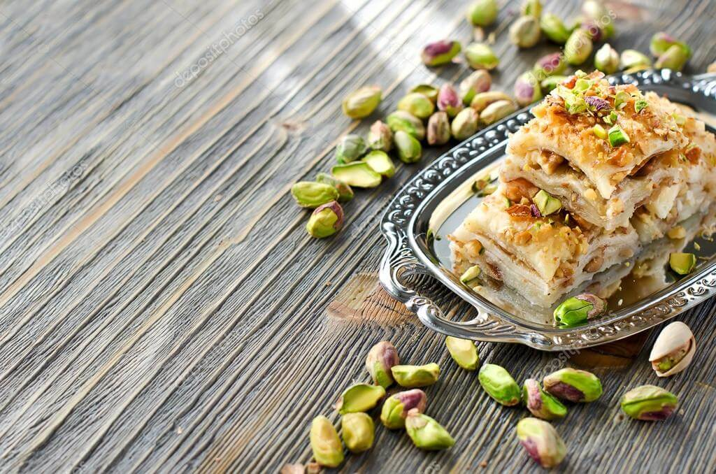 baklava is skillfully made with phyllo (filo), dough, syrup or honey and nuts.